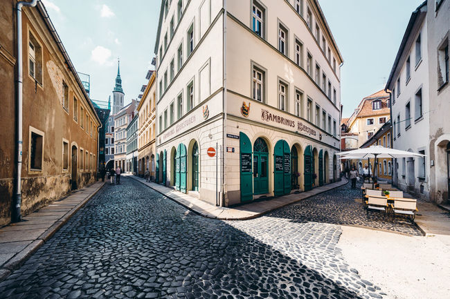 old town Architecture Building Building Exterior Built Structure City City Life Cloud - Sky Cobblestones Day Diminishing Perspective Empty Footpath Narrow Outdoors Residential Building Residential District Residential Structure Street Street Photography Streetphotography The Street Photographer - 2016 EyeEm Awards The Way Forward Town Vanishing Point Walkway Market Reviewers' Top Picks