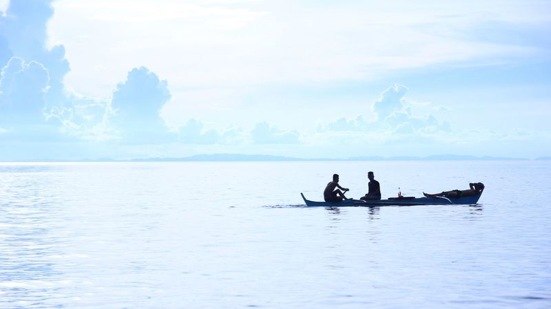 Scenic view of People on a small boat against the blue sky Water Sky Nature Real People Transportation Sea Nautical Vessel Beauty In Nature Scenics Men Cloud - Sky Silhouette Outdoors Waterfront Mode Of Transport Day Oar Horizon Over Water Tranquility Togetherness The Great Outdoors - 2017 EyeEm Awards The Traveler - 2018 EyeEm Awards