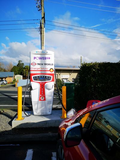 Topping up! Electric Vehicle Electric Vehicle Charging Station NZ #Waihi Nissanleaf Nzev Evnz Ev Road Sign City Text Sky Cloud - Sky