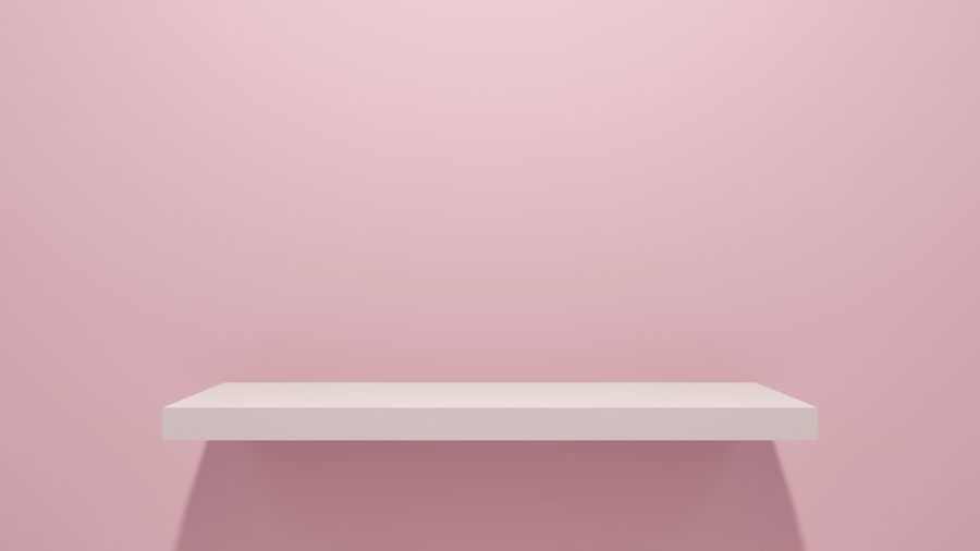 Low angle view of empty paper against pink background