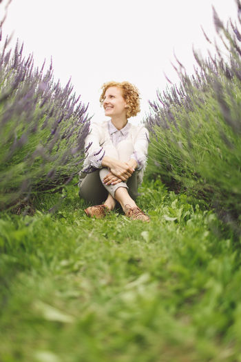 Blone  Casual Clothing Curly Hair Field Flowers Focus On Foreground Girl Grass Grassy Green Color Growth Lavanda Lavander Lavander Flowers Lavanderfields Leisure Activity Lifestyles Outdoors Plant Portrait Selective Focus Smiling Tranquility People And Places Breathing Space Moments Of Happiness
