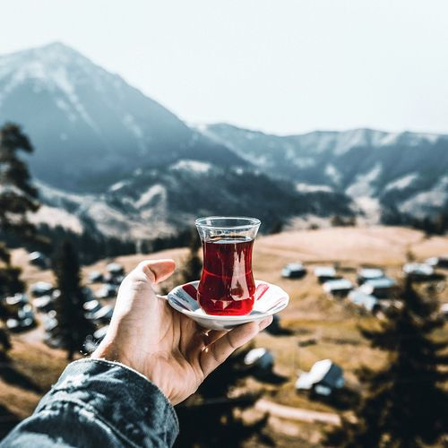 Turkish tea towards to north Highlands? Hand Human Hand Human Body Part Refreshment Drink One Person Holding Personal Perspective Mountain Food And Drink Focus On Foreground Glass Cold Temperature Mountain Range Body Part Day Nature Lifestyles Leisure Activity Drinking Glass