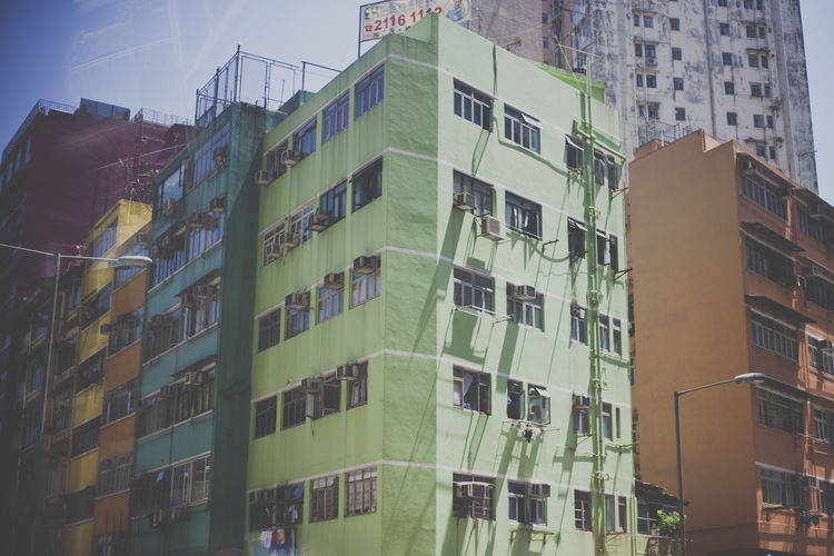 Apartment Architecture Building Building Exterior Building Story Built Structure China City City City Life Colorful Buildings Day Development Green Color Hong Kong Low Angle View No People Office Building Outdoors Sky Skyscraper Tall - High Window