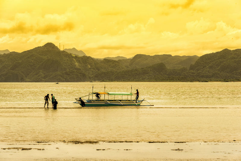Adult Beach Caramoan Island, Camarines Sur Day Mountain Nature Outdoors People Real People Scenics Sea Sky Sunset Water