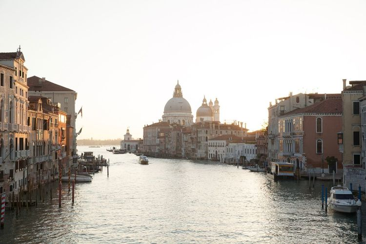 Grand canal against clear sky in city