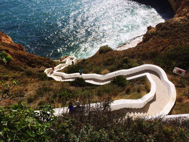 Escaleras al paraíso Stairs Beach Sea Iberia Atlantic Ocean Portugal Algarve Nature Beauty In Nature Day High Angle View Curve Mountain Tranquility Winding Road Water Outdoors No People Scenics Animal Themes Tree EyeEmNewHere