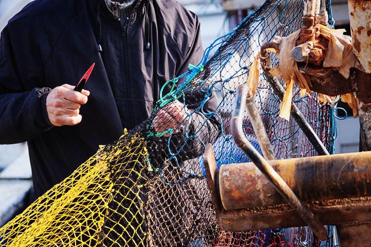 Repairs Boat Fisherman, Rowing, Boat, Row Boat, Lake, River, Paddle, Paddling, Blue Fishing Net, Dragnet, Drift Net, Trawl, Meshwork, Webbing, Tulle, Fishnet, Openwork, Lace, Latticework. Snare, Catch Istanbul, Turkey, Bosphorus, Sea, Europe, European, Asia, Asian, Country, Golden Horn, Bosphorus, Bosphorous Straights, Net Occupation, Profession, Trade, Position, Career, Work, Line Of Work, Livelihood, Repairing Tools, Needle, Mesh