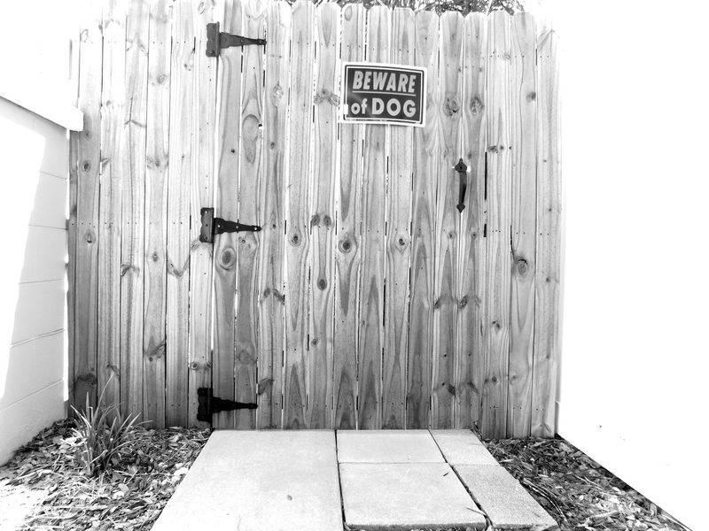 Monochrome Photography Beware Of Dog Warning Sign Warning Danger Gate Fence Wooden Fence Lines Lines And Shapes Shapes And Patterns  Outdoors Beautifully Organized Boundary Backyard Residential Structure Residence Residential  Private Property BewareOfDog Blackandwhite Notes From The Underground Pattern, Texture, Shape And Form Patterns Barrier