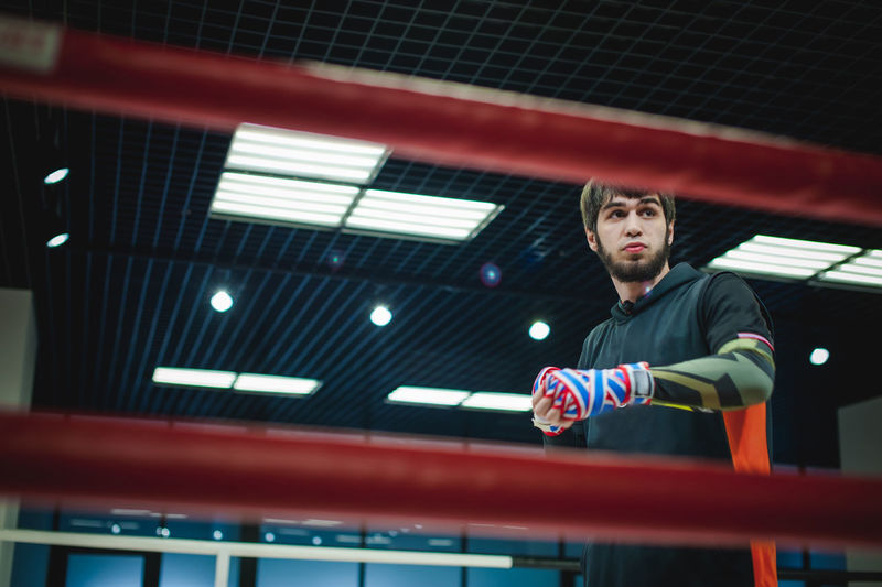 Low angle view of male boxer in boxing ring