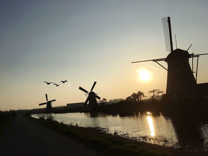 Sunset Water Silhouette Reflection Nature Sky Nautical Vessel Outdoors Windmill Beauty In Nature Alternative Energy No People Renewable Energy Day