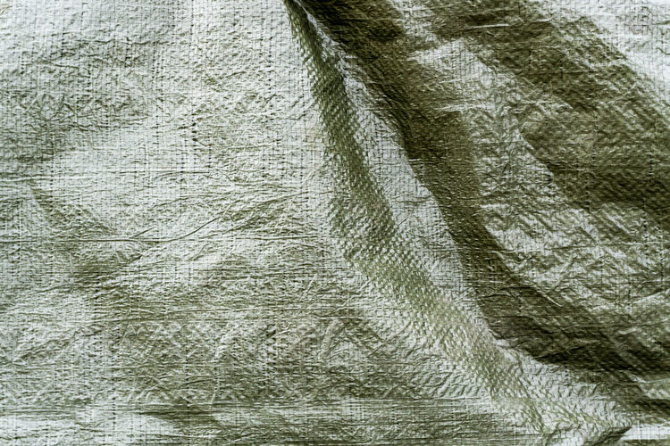 Berlin, Germany, September 22, 2018: Full Frame Close-Up of Green Woven Tarpaulin Berlin Germany 🇩🇪 Deutschland Color Image Horizontal Outdoors No People Backgrounds Full Frame Textured  Close-up Pattern Material Crumpled Rough Green Color Still Life Textured Effect Woven Tarp Tarpaulin Textile Protection Cover Security Safety