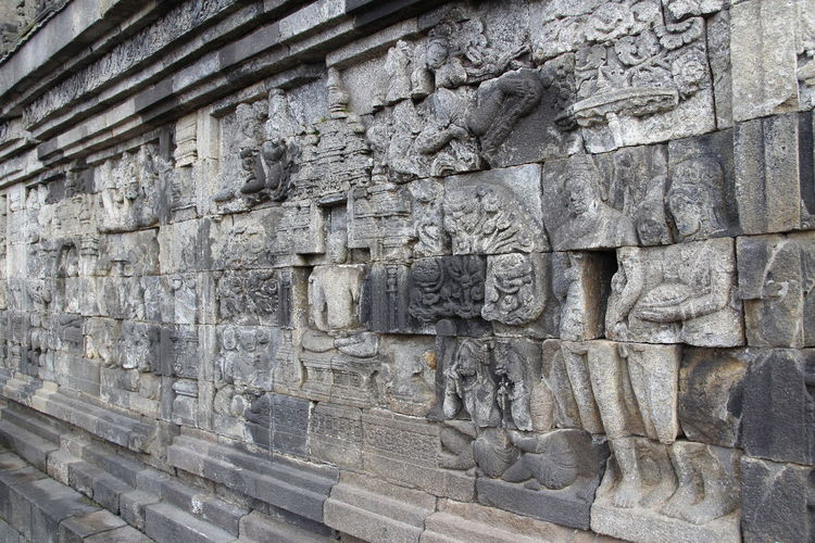 Beautiful bas-relief wall decor carved in stone at Borobudur Temple, Yogyakarta, Indonesia Carvings In Stone INDONESIA Wall Yogyakarta Ancient Ancient Civilization Architecture Art And Craft Bas-relief Borobudur Buddhism Built Structure Carving Carving - Craft Product Craft History Human Representation No People Representation Rocks Sculpture Stone Material Stone Wall The Past Wall - Building Feature