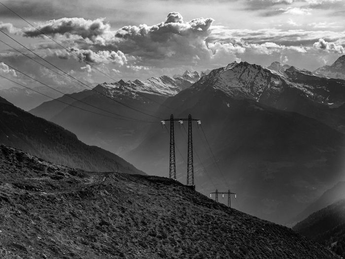 Beauty In Nature Cable Cloud - Sky Connection Day Electricity  Electricity Pylon Environment Formation Landscape Mountain Mountain Peak Mountain Range Nature No People Non-urban Scene Outdoors Power Line  Power Supply Scenics - Nature Sky Snowcapped Mountain Technology Tranquil Scene Tranquility