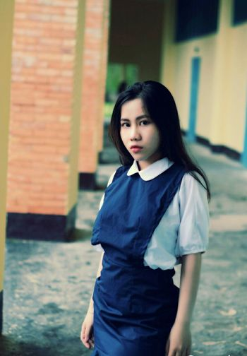 Portrait of teenage girl wearing school uniform
