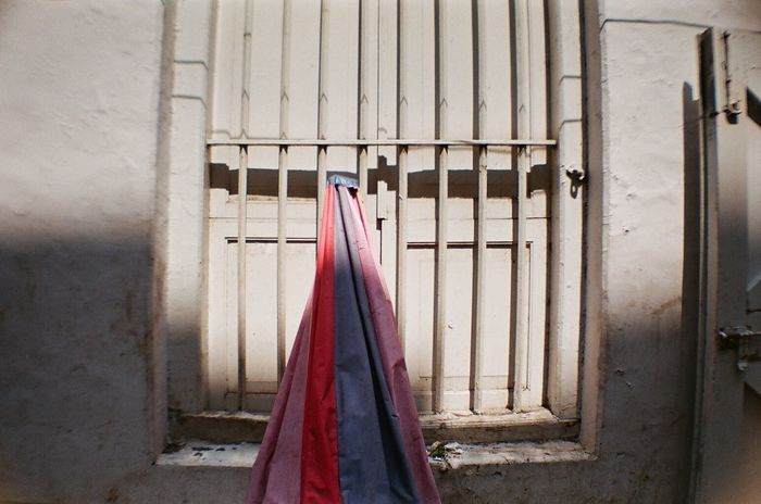 jakarta still life 35mm Film Alley Analogue Photography Banal Building Everyday Film Photography Filmisnotdead Jakarta Jakarta Indonesia Light And Shadow Mundane No People Street Photography Streetphotography Textures And Surfaces Travel Photography Umbrella Wall Showcase June Window Bars Rainbow Colors Fine Art Photography TakeoverContrast