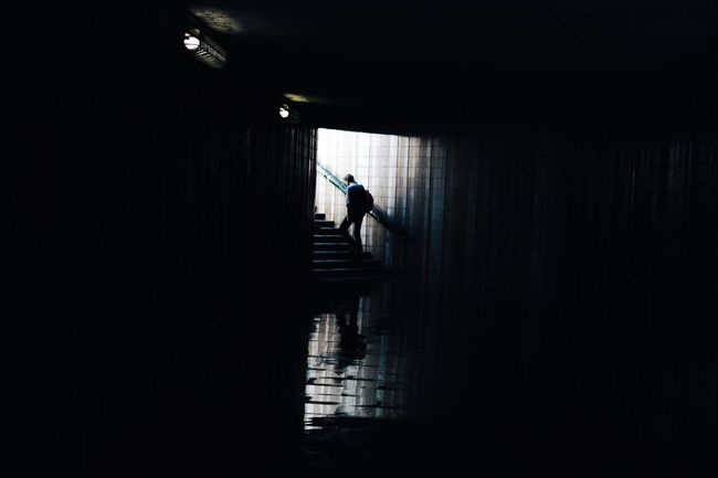 Lost in Prague Full Length Walking Silhouette Indoors  Corridor Built Structure Architecture Rear View Steps Reflection Day Dark The Way Forward Distant Pedestrian Walkway Light At The End Of Tunnel City Life Streetphotography Street Peopleandplaces People And Places