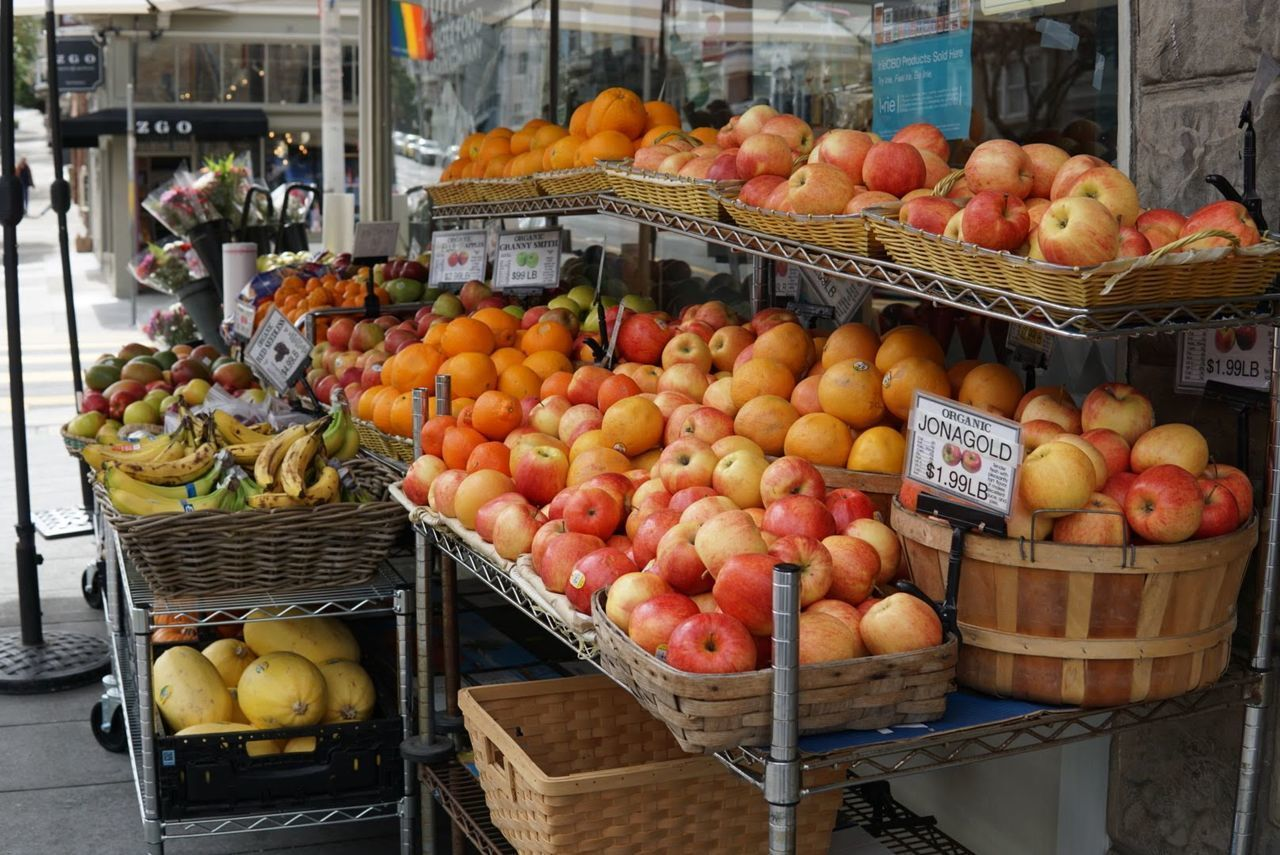 food, healthy eating, food and drink, fruit, freshness, market, wellbeing, container, choice, retail, abundance, market stall, large group of objects, orange color, for sale, variation, apple - fruit, orange, basket, orange - fruit, no people, sale, outdoors, retail display, apple, variety, ripe