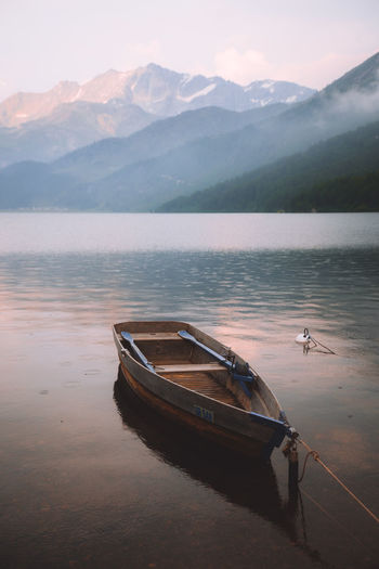 Sunsets and Raindrops Beauty In Nature Boat Day Lake Mode Of Transport Mountain Mountain Range Nature Nautical Vessel No People Outdoors Rowboat Scenics Sky Tranquil Scene Tranquility Transportation Water Waterfront