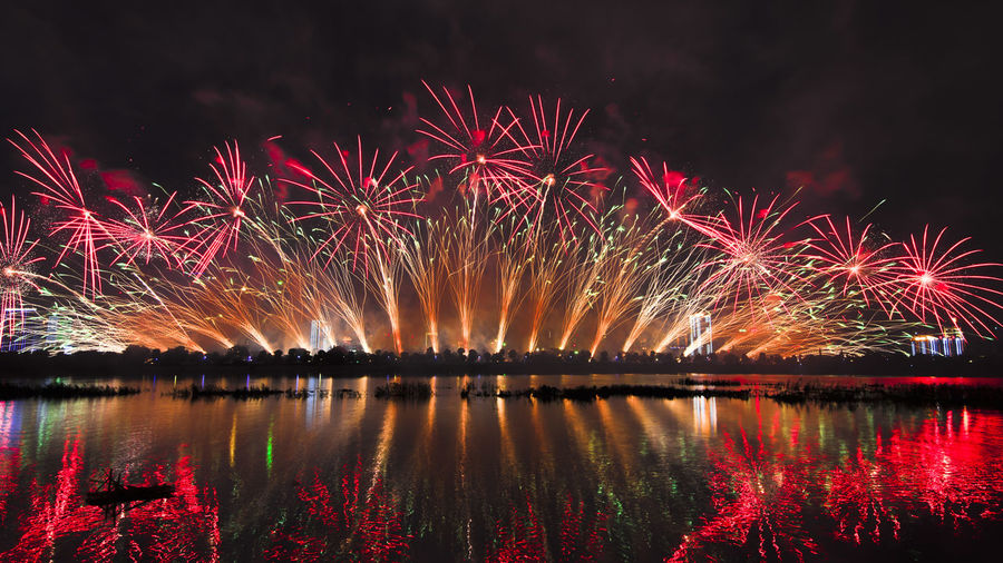 Reflection Of Firework Display On River At Night