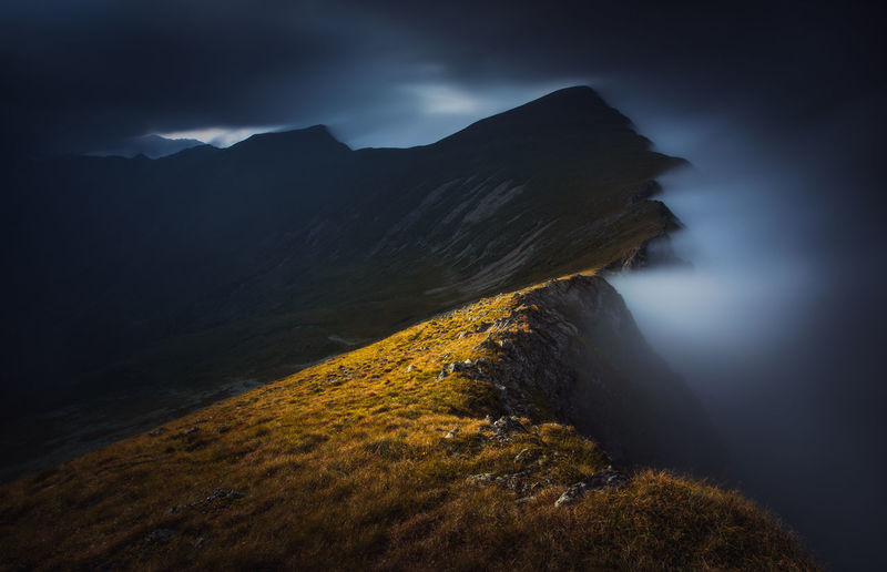 Incredible light at sunset in a cloudy day from fagaras mountains, romania.