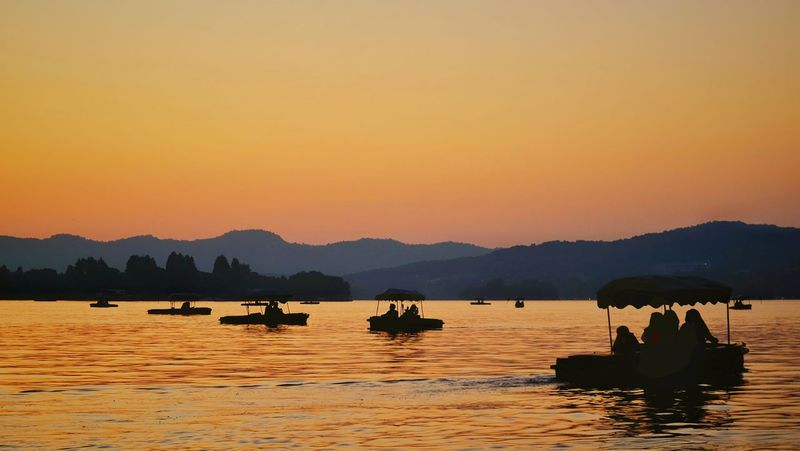 Mountain Silhouette Sunset Water Lake Landscape Outdoors Tranquility China View Lake View West Lake, Hangzhou Vacations Light And Shadow Hangzhou,China Travel Yellow Warm Glow Summer Boat
