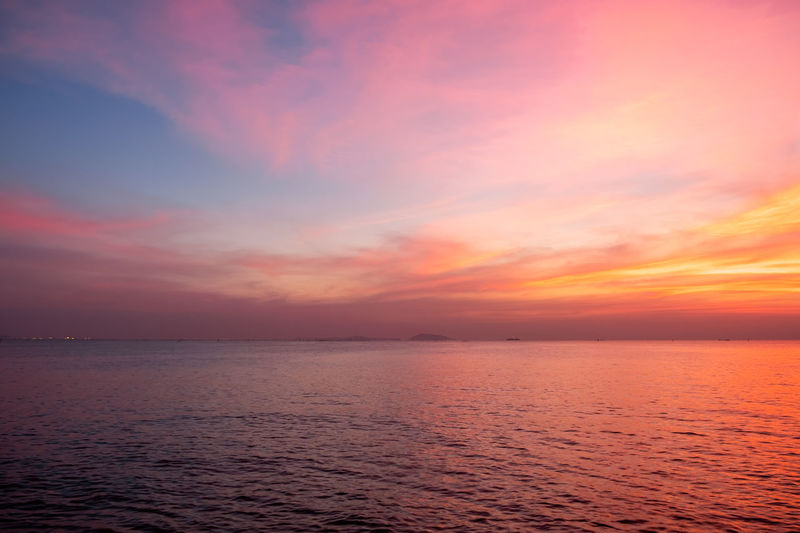 Sea Sky Water Sunset Scenics - Nature Horizon Over Water Cloud - Sky Beauty In Nature Horizon Tranquility Dramatic Sky Tranquil Scene Nature Seascape Urban Skyline Dusk No People Idyllic Environment Sun Saturated Color Romantic Sky Outdoors Freedom