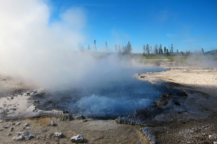 Steam Emitting From Hot Spring At Yellowstone National Park