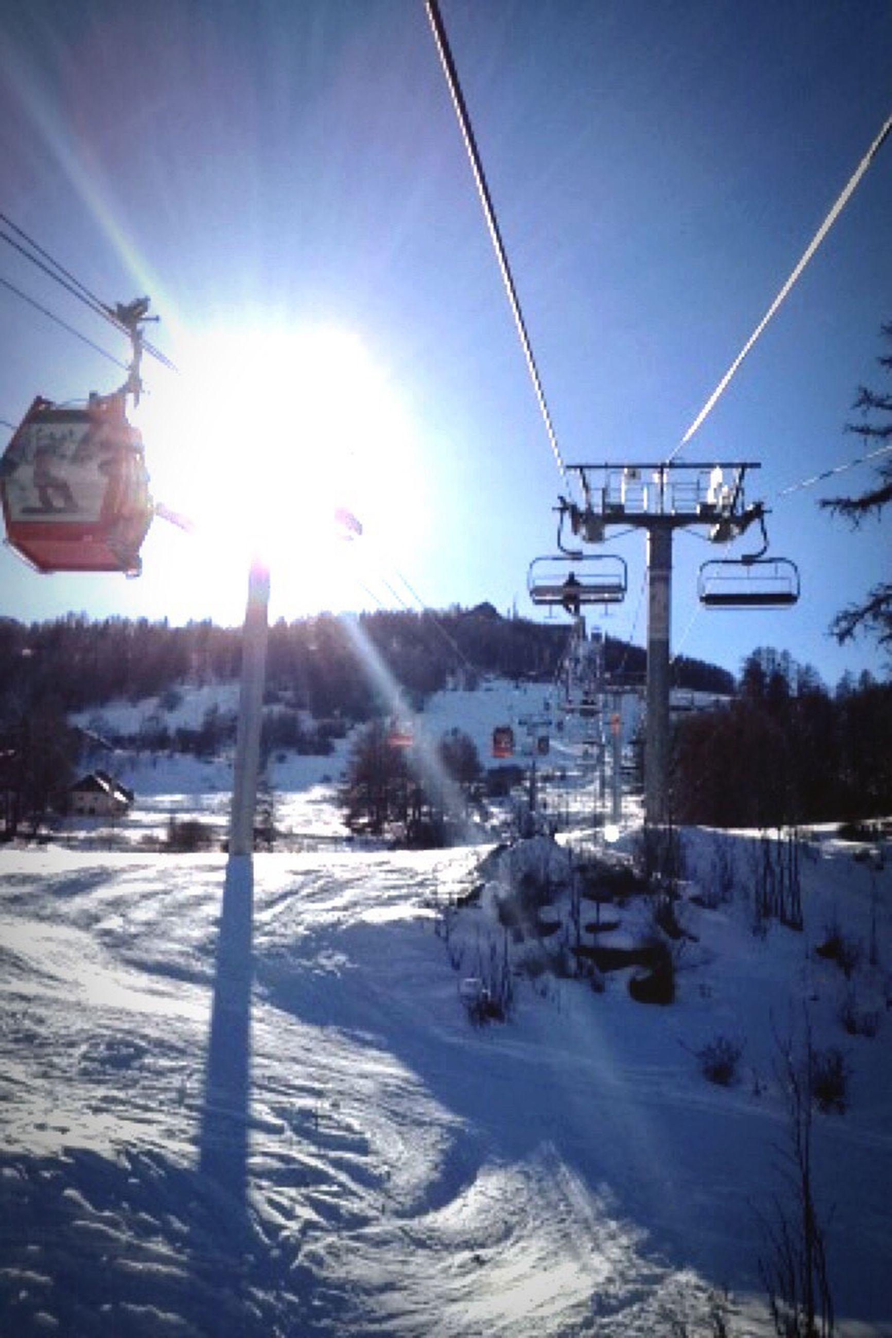 snow, winter, cold temperature, sun, season, sunbeam, sunlight, transportation, weather, lens flare, mode of transport, covering, clear sky, ski lift, sky, nature, bright, sunny, frozen, white color
