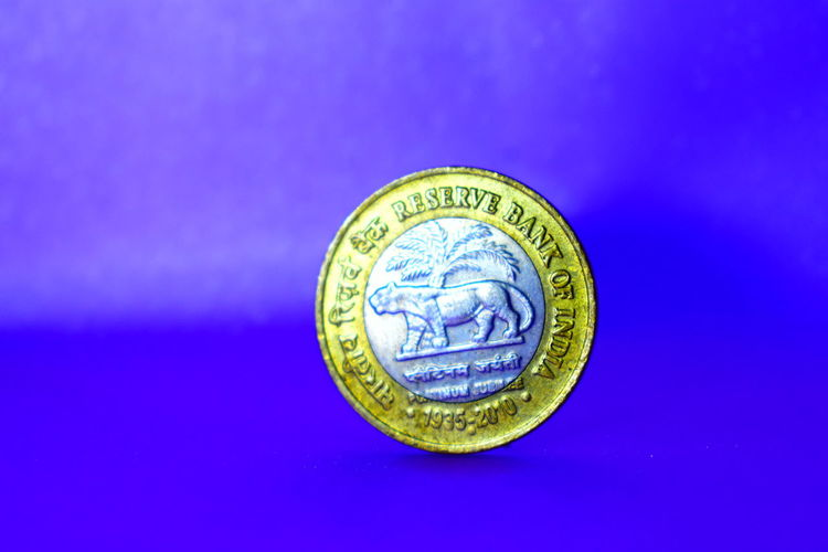 Man Made Object Indian Coin Blue Background Reserve Bak Of India Business Currency Paper Currency Coin Savings Colored Background Business Finance And Industry Finance Wealth Blue Coin Bank Money