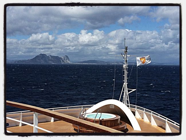 The Seabourn Quest sails by the Rock of Gibraltar