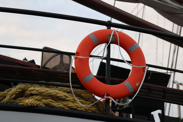 Low angle view of rope tied on boat