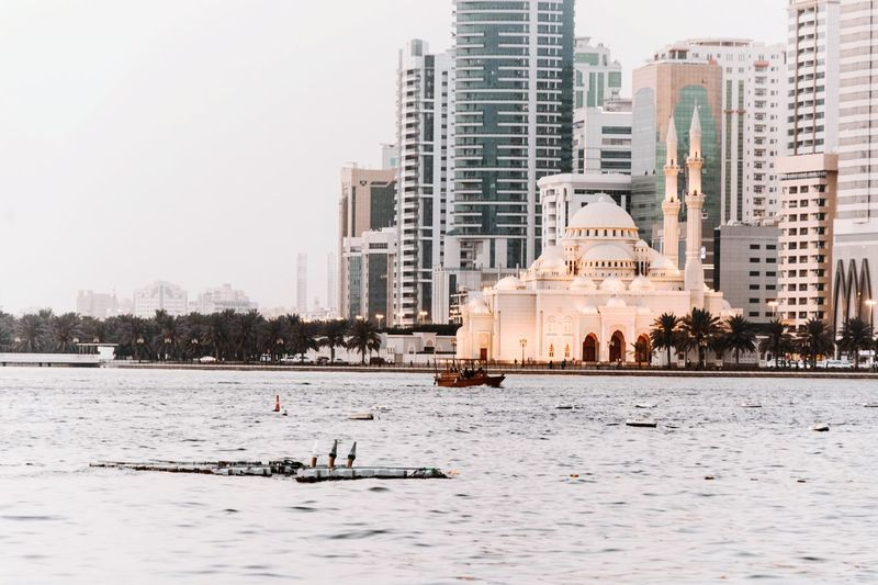 Buildings Sharjah Corniche Sharjah Sharjah Uae Sunset Architecture City No People Outdoors Day Water Culture And Entertainment Outdoors Photograpghy  Attraction Culture And Tradition Cultural Heritage Tradition Mosque Al Majaz Corniche