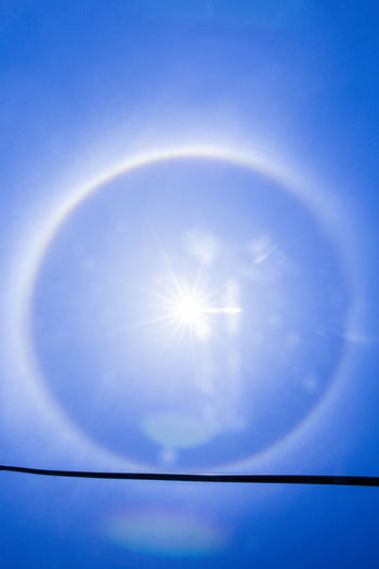 Low angle view of bright sun