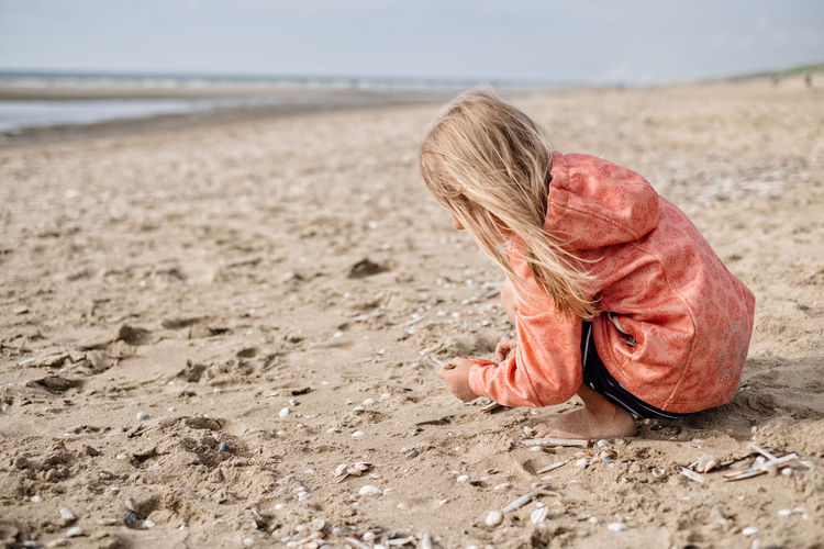 Sea Beach Water Nature Hair Holiday Child Day Offspring Outdoors Trip Childhood Sand Vacations Land Hairstyle Blond Hair Full Length My Best Photo One Person Real People Lifestyles Girls Innocence Females The Photojournalist - 2019 EyeEm Awards