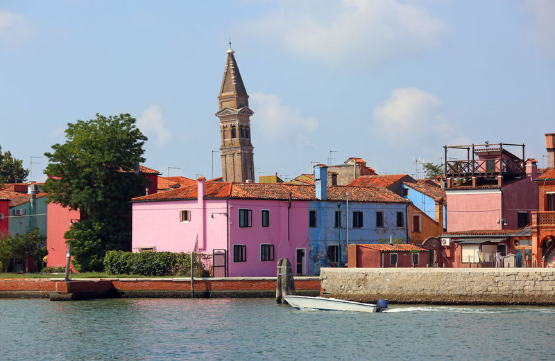 leaning bell tower of the Church and colroed houses of Burano Island near Venice Burano, Italy Burano, Venice Houses Architecture Belltower Building Building Exterior Built Structure Burano Burano Colored Houses Burano Island Burano Isle Burano Venice City Day No People Outdoors Religion Sky Spire  Tower Travel Destinations Venice Water Waterfront