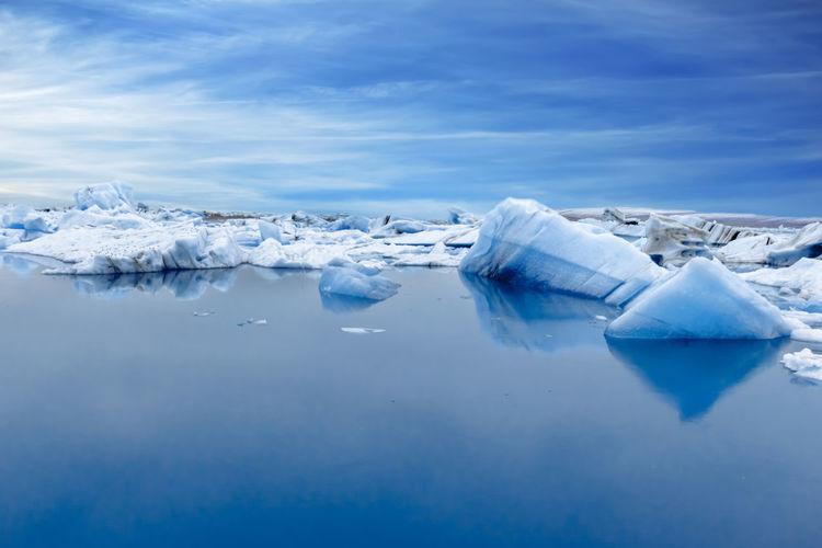 Frozen lake against sky