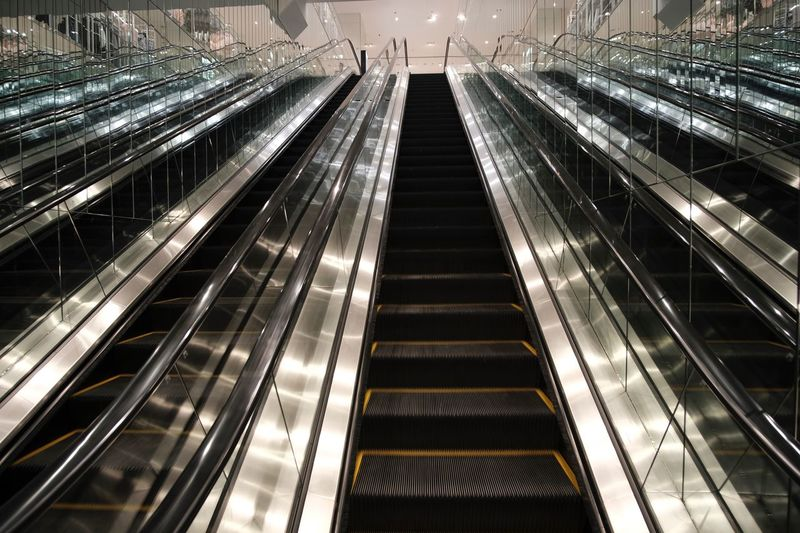 Escalator Stairs Escalators Transportation High Angle View Architecture Built Structure Rail Transportation Track Railroad Track City Illuminated Technology No People Building Exterior Mode Of Transportation Modern Metal Public Transportation Outdoors Connection Railroad Station