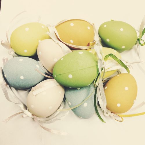 High Angle View Of Colorful Easter Eggs And Ribbons On White Background