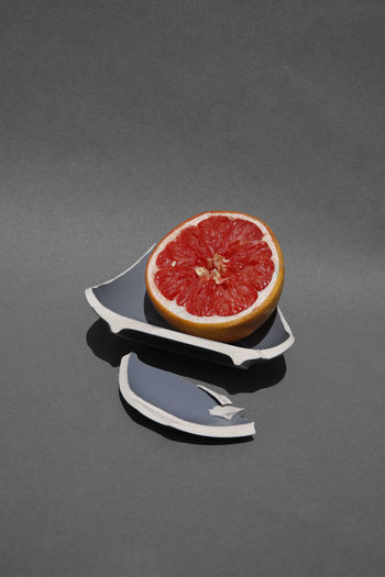 Blood orange against black background