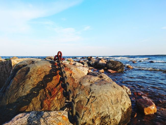Sea Horizon Over Water Water Sky Beach Scenics Beauty In Nature Nature Rock - Object Day Tranquility One Person Outdoors Wave Chain Rusty Finding New Frontiers Still Life BYOPaper! Live For The Story The Great Outdoors - 2017 EyeEm Awards Place Of Heart