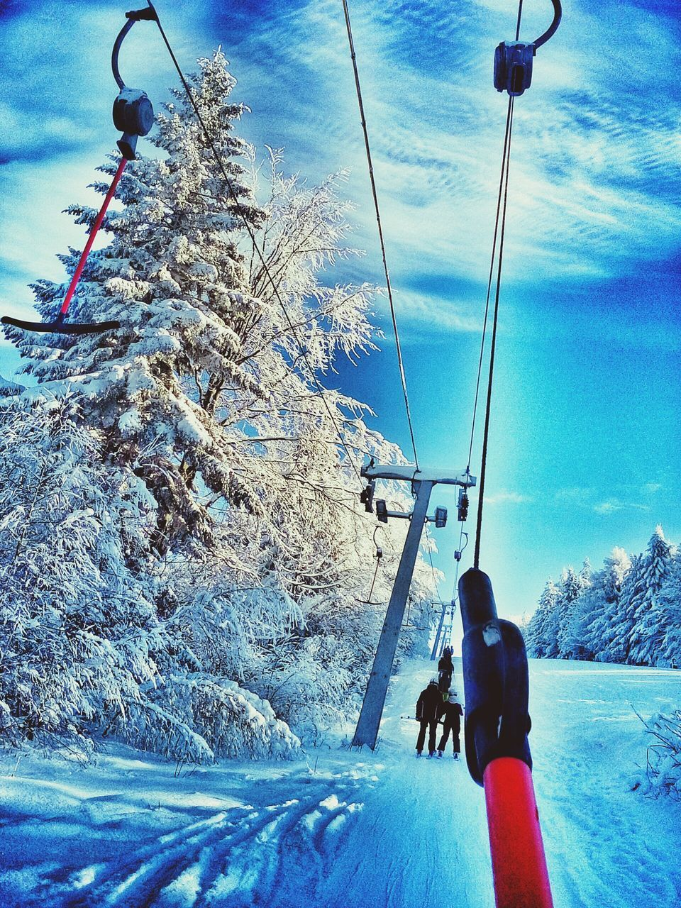 snow, cold temperature, winter, weather, real people, nature, leisure activity, frozen, sky, adventure, day, lifestyles, outdoors, tree, ski lift, beauty in nature, vacations, transportation, mountain, full length, men, cloud - sky, snowcapped mountain, cable, overhead cable car, scenics, extreme sports, warm clothing, people
