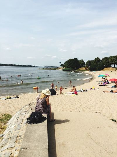 Water Beach Sky Land Real People Nature Sand Group Of People Sunlight Large Group Of People Incidental People Leisure Activity Vacations Outdoors Sea Cloud - Sky Day Trip Crowd Holiday