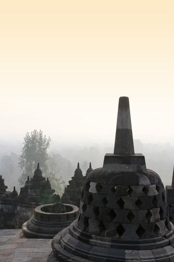 Borobudur Temple with the mysteries forest surrounding during sunrise, Yogyakarta, Indonesia Yogyakarta, Indonesia Ancient Civilization Architecture Belief Borobudur Buddhism Building Built Structure Fog Forest History Nature No People Outdoors Place Of Worship Plant Religion Sky Spirituality Travel Destinations Tree