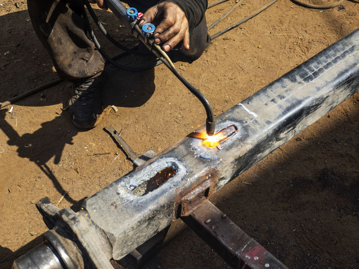 Low Section Of Manual Worker Heating Metal Outdoors