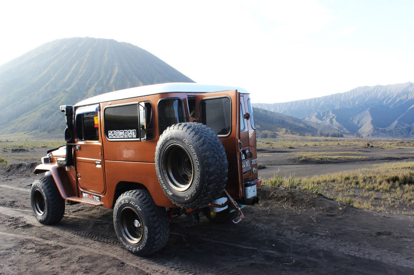 Orange Jeep in Bromo area. Bromo Bromo Mountain Day East Java Indonesia Jeep No People Old-fashioned Outdoors