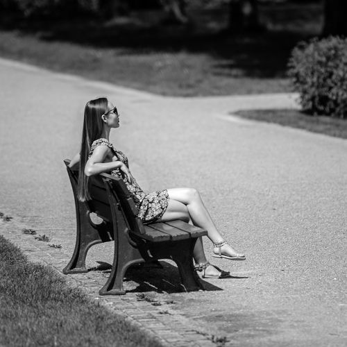 """""""In the Garden of the Court"""" Adult Beautiful Woman Day Fashion Females Focus On Foreground Full Length Hairstyle Land Leisure Activity Lifestyles Nature One Person Outdoors Plant Real People Side View Sitting Sunlight Women Young Adult Young Women The Art Of Street Photography My Best Photo"""