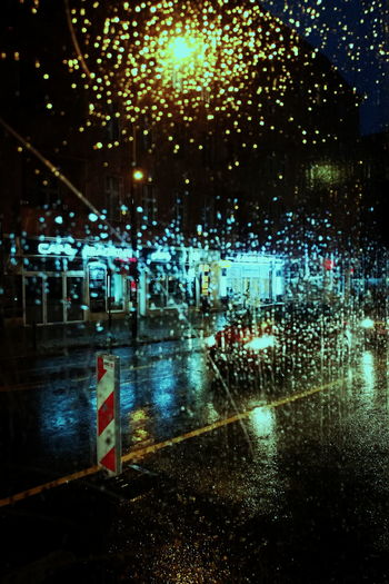 Wet road at night during rainy season