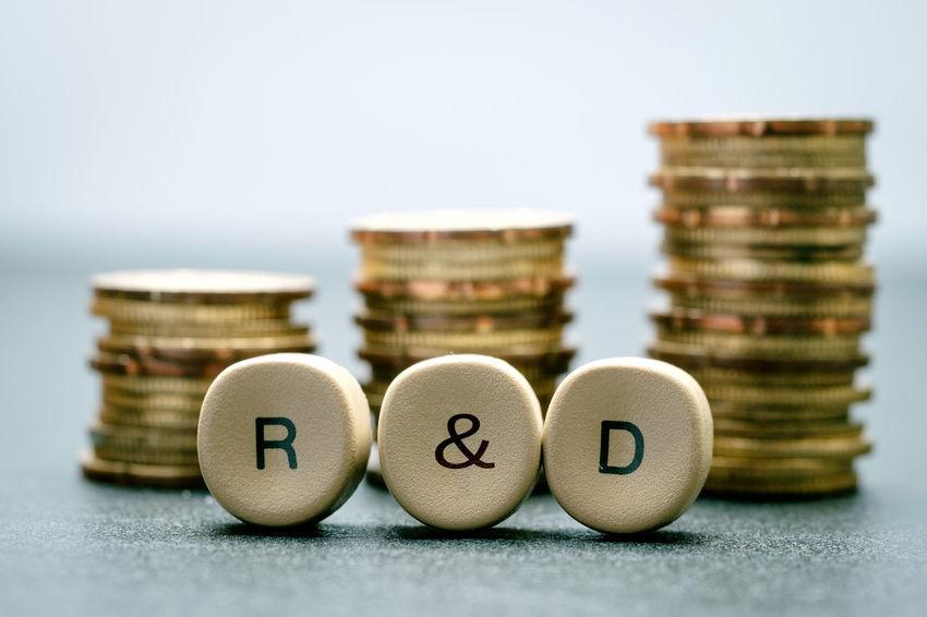 R&D funding concept R&D Arrangement Concept Focus On Foreground Fund Money No People Stack Studio Shot