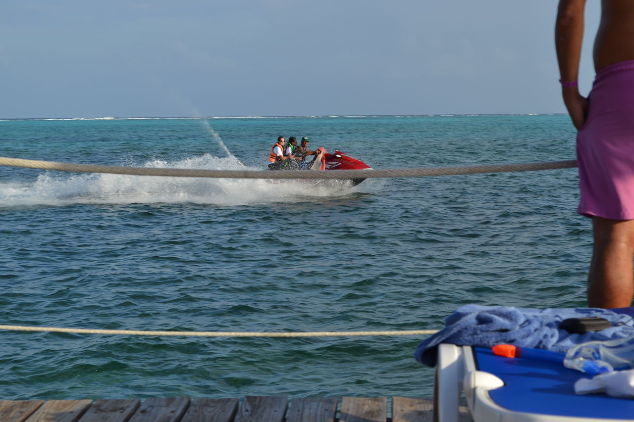 sea, water, real people, men, horizon over water, nautical vessel, transportation, nature, outdoors, mode of transport, day, adventure, leisure activity, motion, lifestyles, sky, scenics, women, jet boat, people