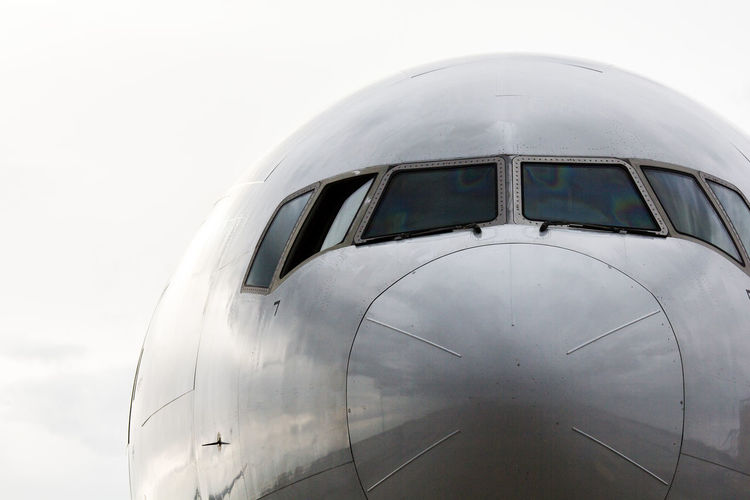 Close-up of airplane against clear sky